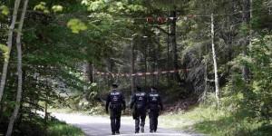 German police officers patrol the forest around the hotel castle Elmau in Kruen
