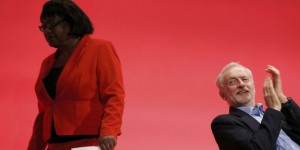 Britain's opposition Leader of the Labour Party Jeremy Corbyn applauds as Diane Abbott shadow International Development walks on stage at the annual Labour Party Conference in Brighton, southern Britain