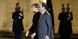 French President Hollande arrives with German Chancellor Angela Merkel at the Elysee Palace in Paris