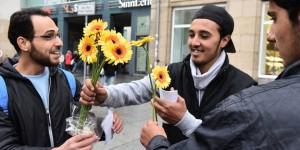 Flüchtlinge bedanken sich mit Blumen