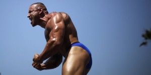 A man competes in the Muscle Beach Independence Day bodybuilding contest on Venice Beach in Los Angeles, California