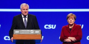Bavarian Prime Minister and head of CSU Seehofer welcomes German Chancellor Merkel to CSU party congress in Munich