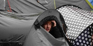 A man looks out from his tent at the Occupy London protest camp outside St Paul's Cathedra