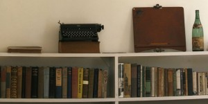 The typewriter used by late Nobel-prize winning author Hemingway is seen next to books and a hunting trophy at Finca Vigia in Havana