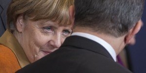 German Chancellor Angela Merkel talks with Turkish Prime Minister Ahmet Davutoglu during a EU-Turkey summit in Brussels